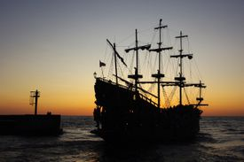 Silhouette of a ship on the water at sunset.