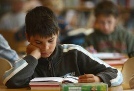 School-age boy reading