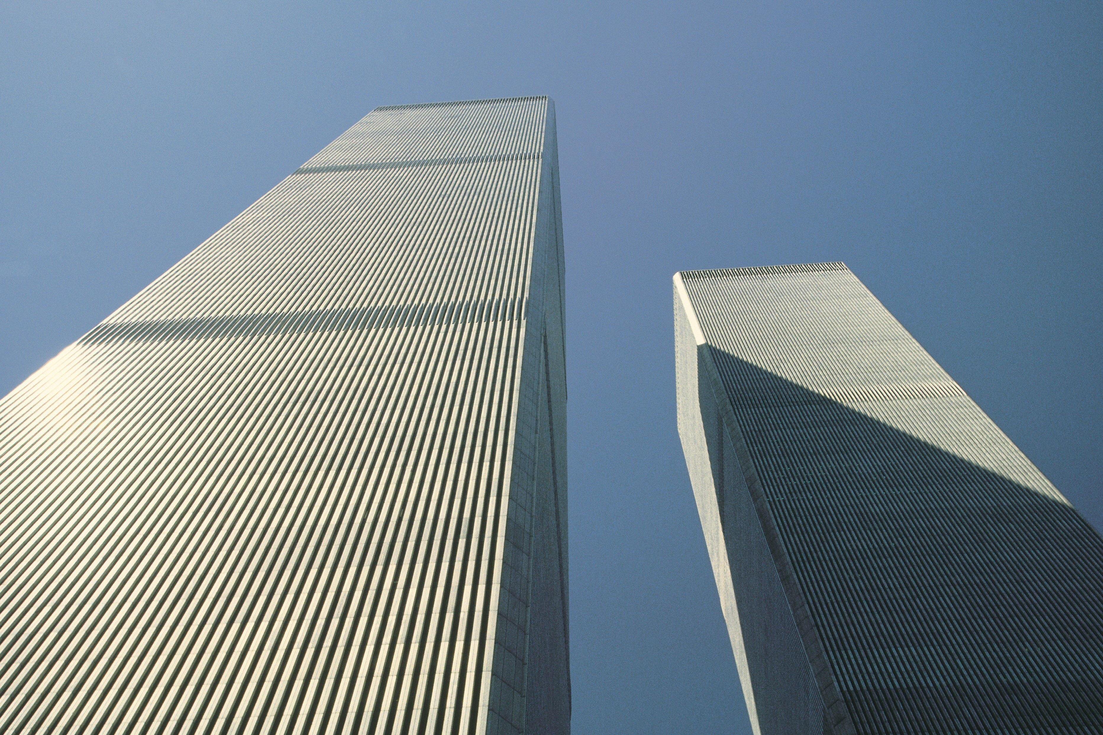 low-angle view of two rectangular skyscrapers near each other