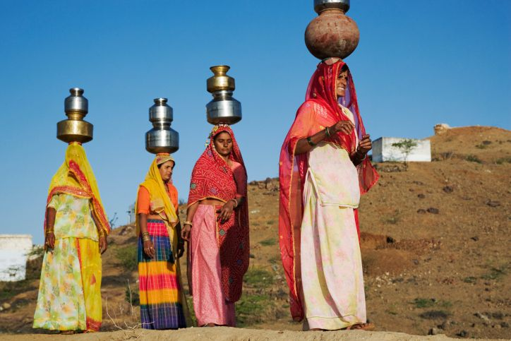 Many rural women in India have to walk miles every day to get water.