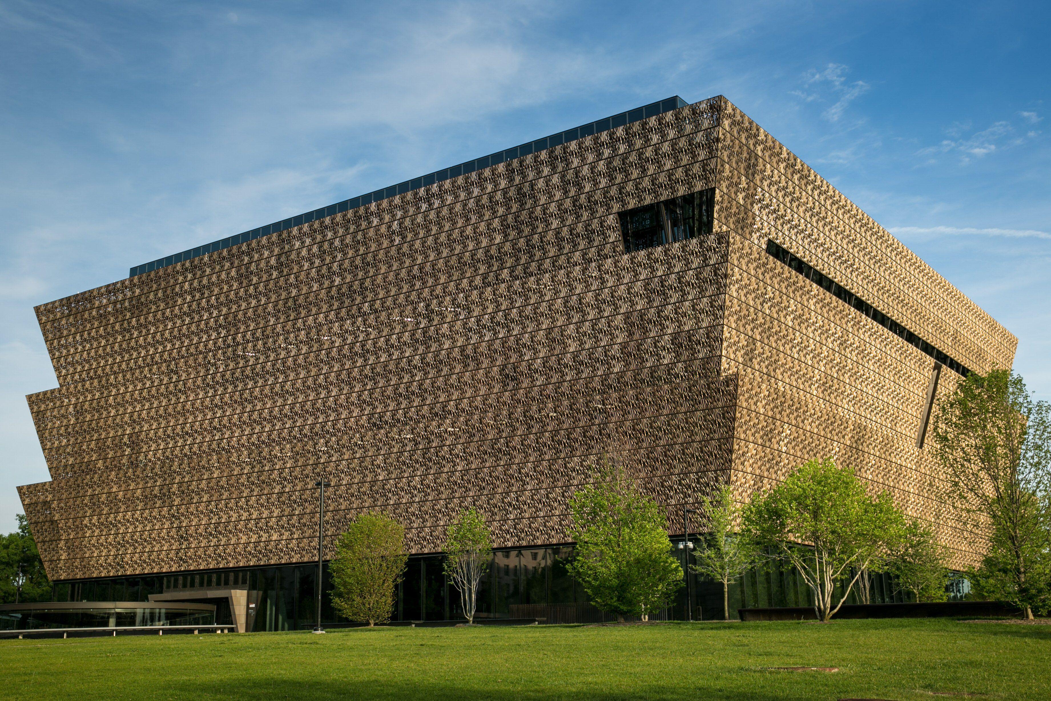 brown, mesh metal exterior of boat hull-like building
