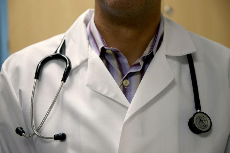A doctor wearing a white lab coat and a stethoscope