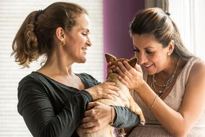 Woman showing another woman her puppy