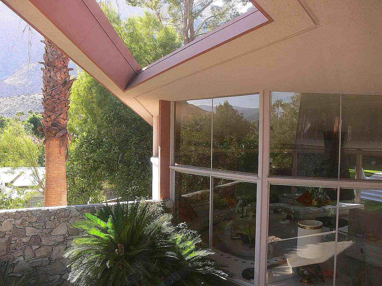 Expansive windows at the Elvis Honeymoon Hideaway in Palm Springs, California