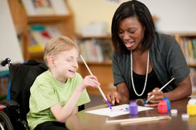 Teacher works with a disabled student