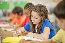 Girl writing in journal