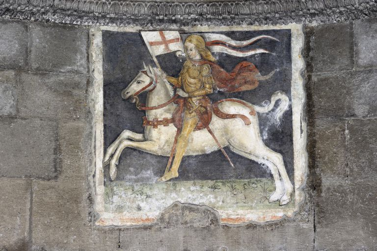 Medieval fresco depicting a knight templar on a horse
