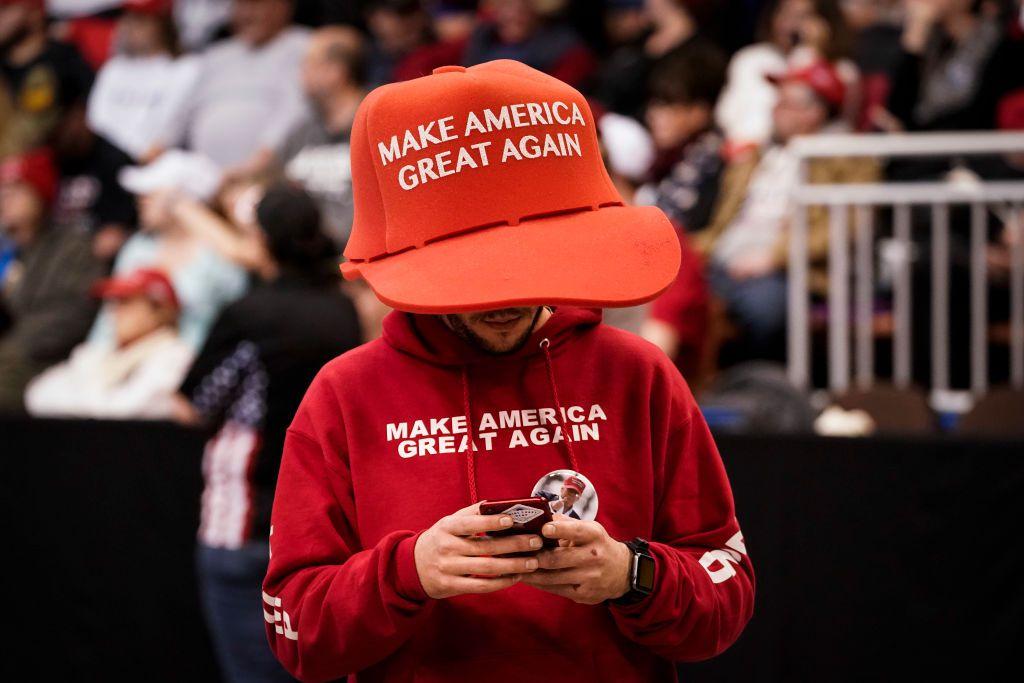 A supporter of U.S. President Donald Trump wears an oversize