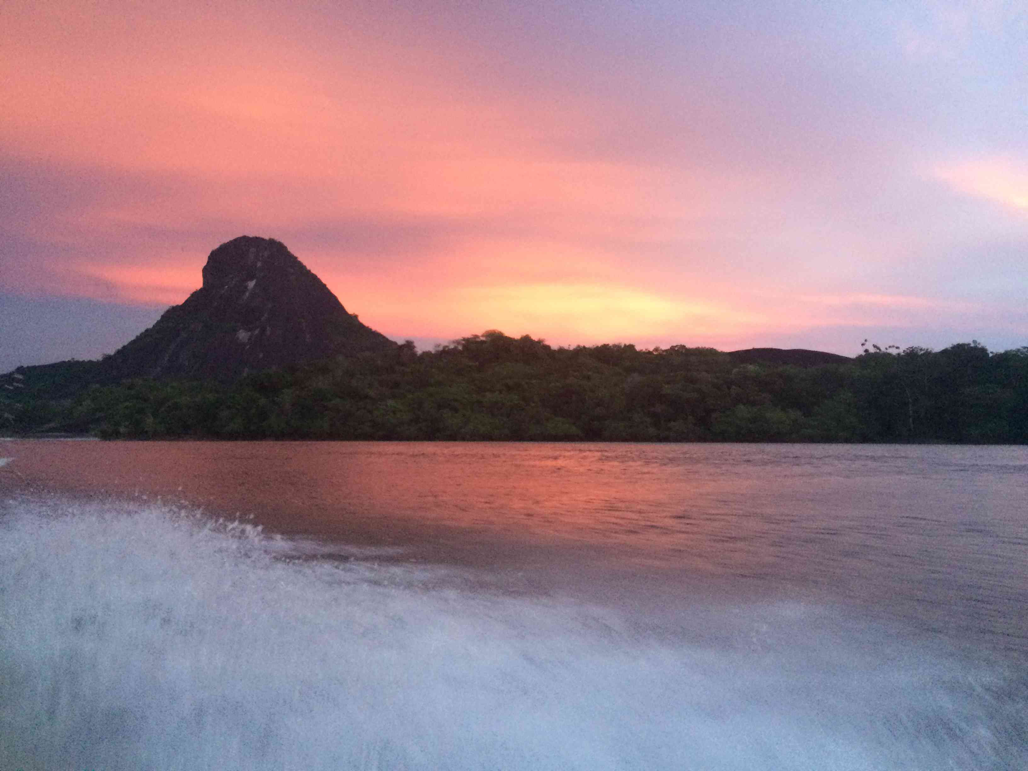 Guiana Shield rock formation in the Amazon rainforest at sunset from the Orinoco river.