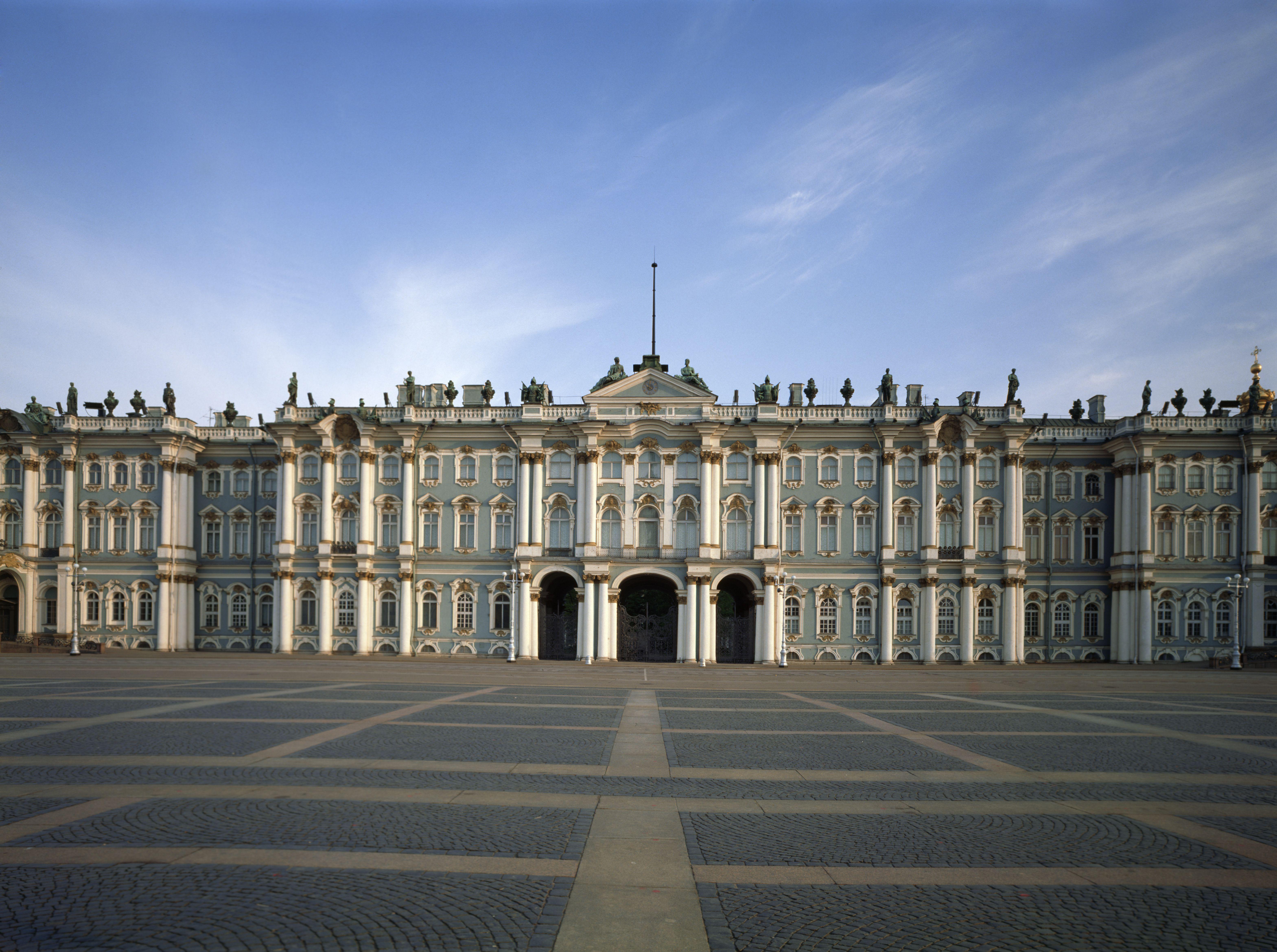 ornate, horizontal-oriented palace facade with masonry plaza entrance