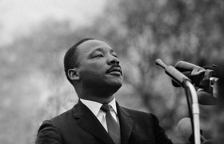 MONTGOMERY, AL - MARCH 25: Dr. Martin Luther King, Jr. speaking before crowd of 25,000 Selma To Montgomery, Alabama civil rights marchers, in front of Montgomery, Alabama state capital building. On March 25, 1965 in Montgomery, Alabama.