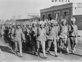 Chinese Soldiers Marching with Weapons