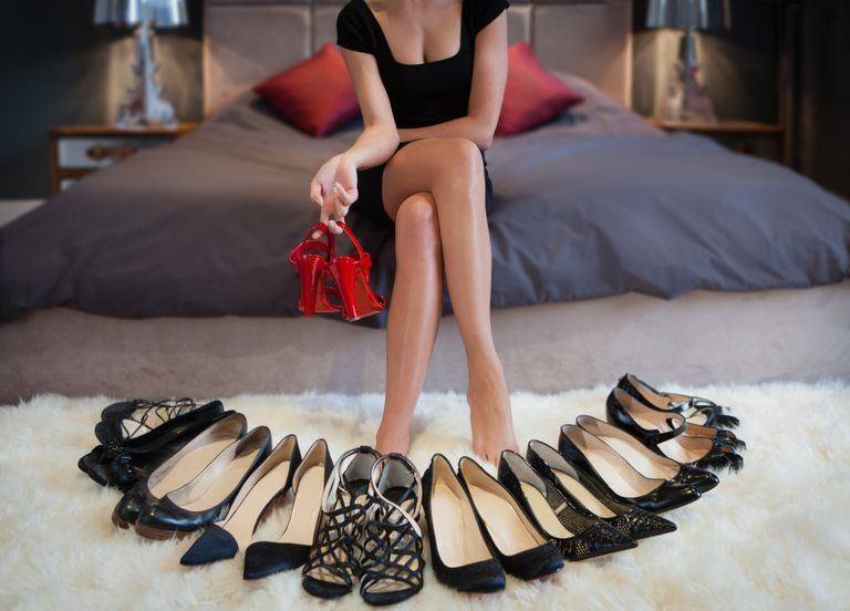 Woman with various types of shoes