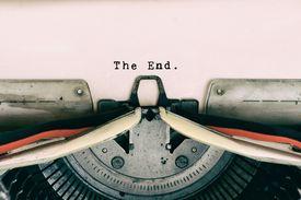 The End words type on Vintage Typewriter
