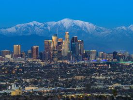 Los Angeles skyline with snowy mountains behind