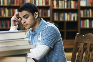 Young man studying in university library