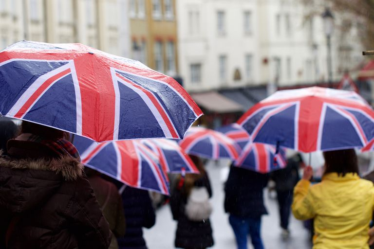 people walking with union jack umbrellas