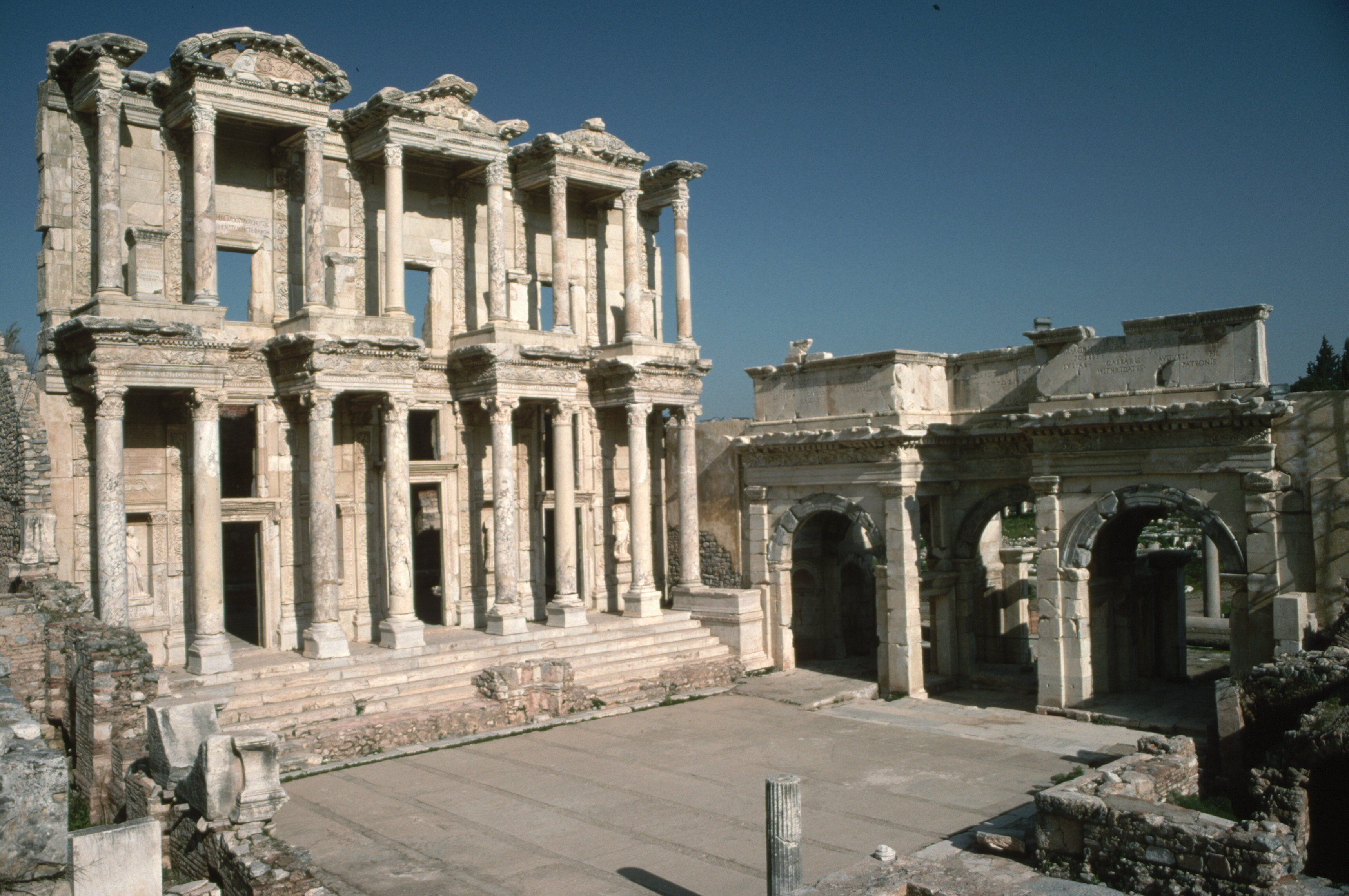 view of ruins, archways of stone, facade of columned pediments