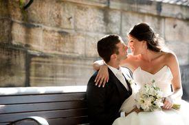 Bride sitting on groom's lap