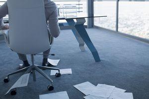 Businessman looking at paperwork on office floor