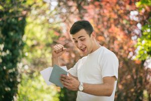 Happy Young Man Receiving Letter