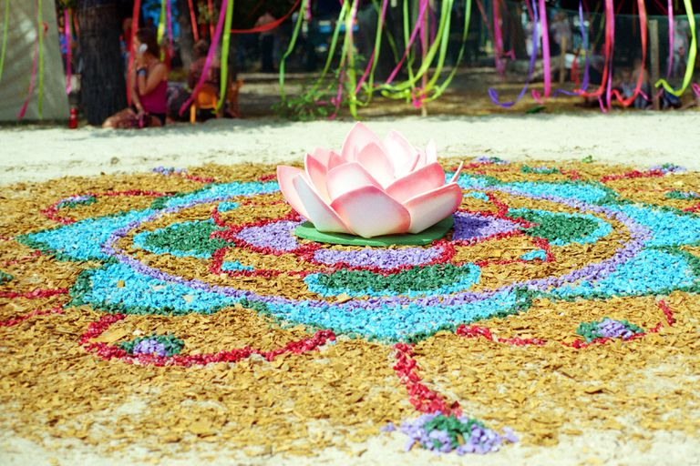 Flower instalation from small colored rocks on vedic festival 'Vedalife'