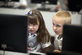 Children using a computer together.