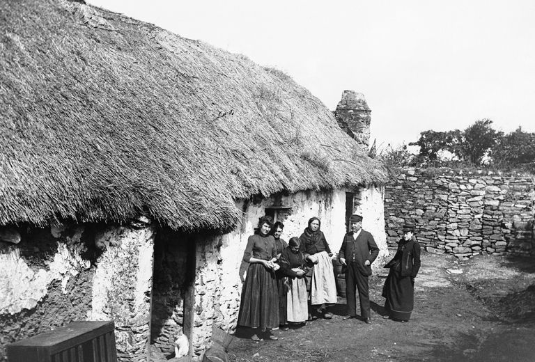 Photograph of thatched-roof cottage in Ireland.
