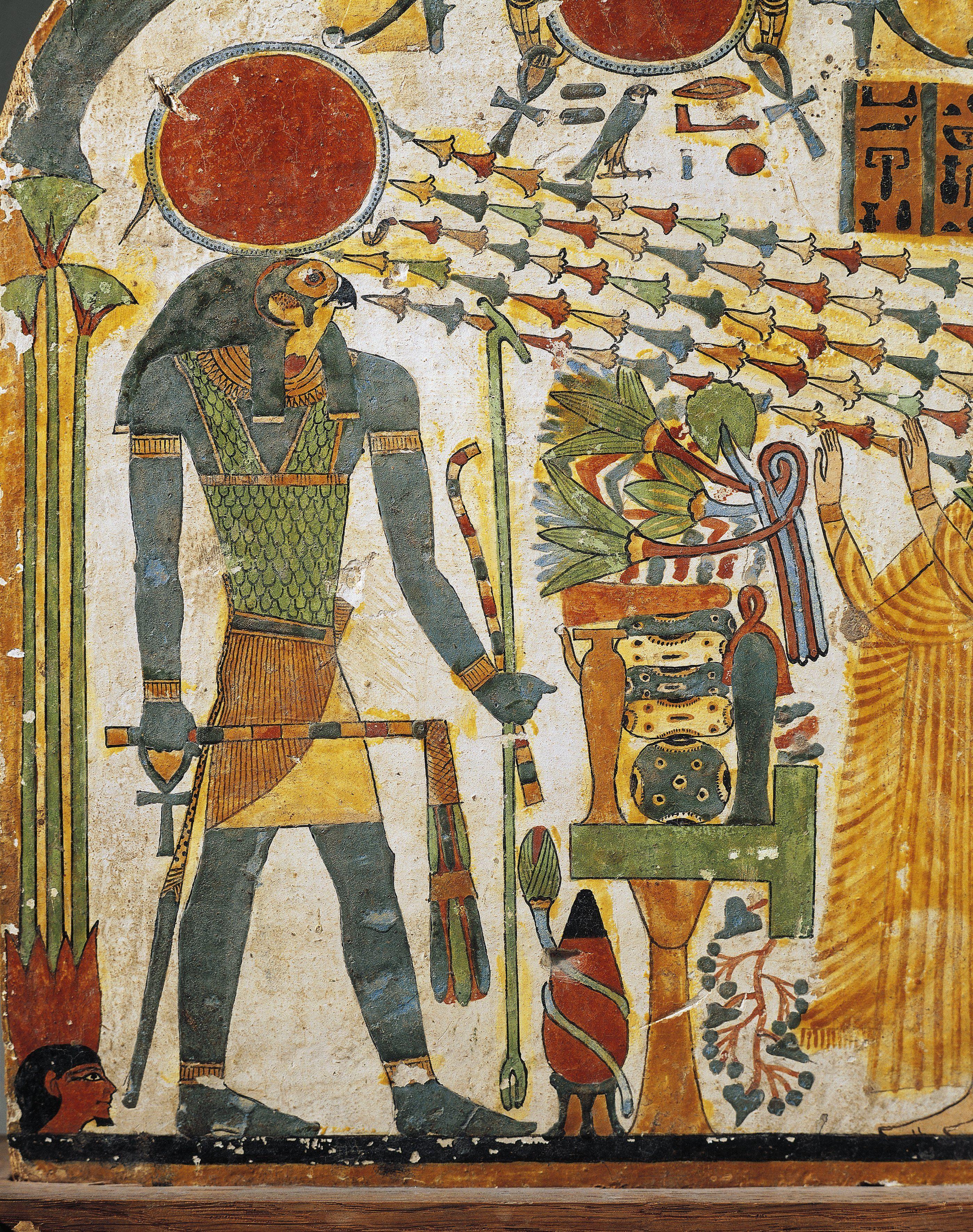 Painted wood depicting sun god Ra.