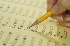 Taking standardized tests in school.