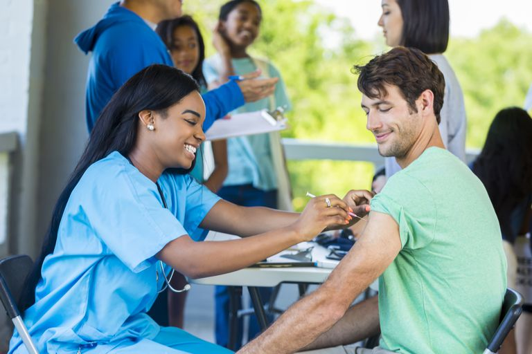 Man receives immunization at outdoor free clinic
