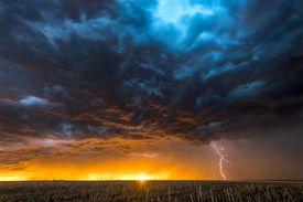 Large lightning strike at dusk on Tornado Alley
