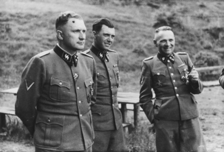 A picture of Dr. Josef Mengele with Richard Baer and Rudolf Hoess at Auschwitz.