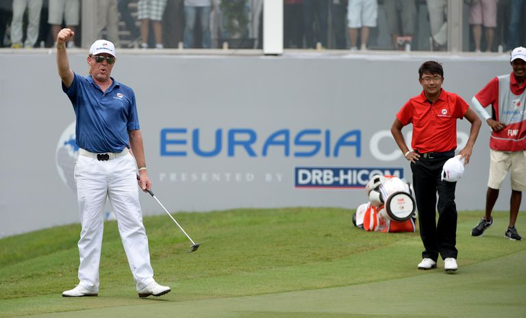 Miguel Angel Jimenez Of Team Europe Celebrates After Holing His Putt On The 18th Green Against