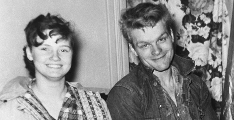 Black and white photograph of Charles Starkweather and Caril Fugate sitting side by side on a couch.