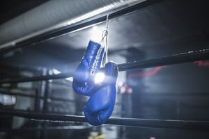 Boxing gloves hanging in boxing ring
