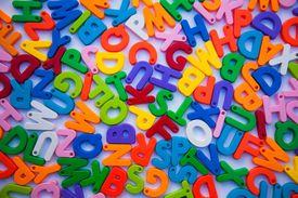 Colorful alphabet blocks on white background