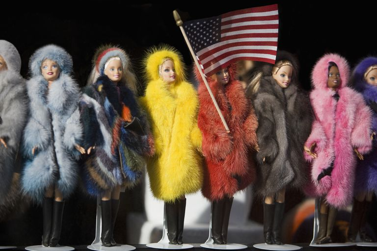 Close-Up of Barbie Fashion Dolls With an American Flag