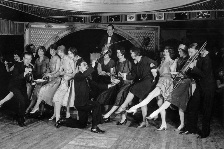 Flappers dance while musicians perform during a dance contest in Charleston, South Carolina, 1926