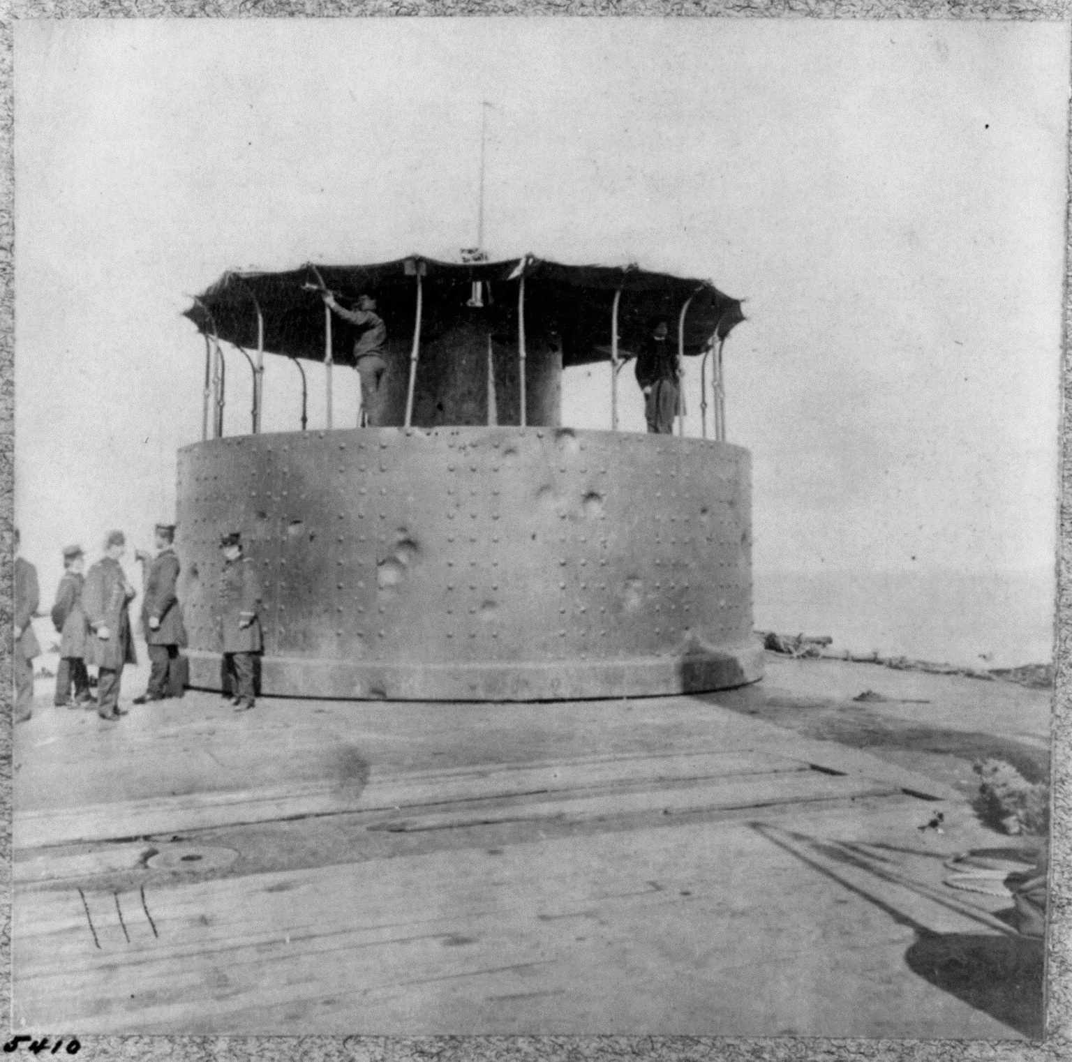 An improved Monitor, the U.S.S. Passaic, photographed to show battle damage to its turret.