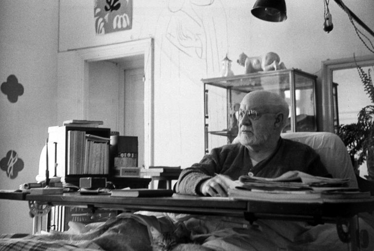 Matisse working at his desk in bed
