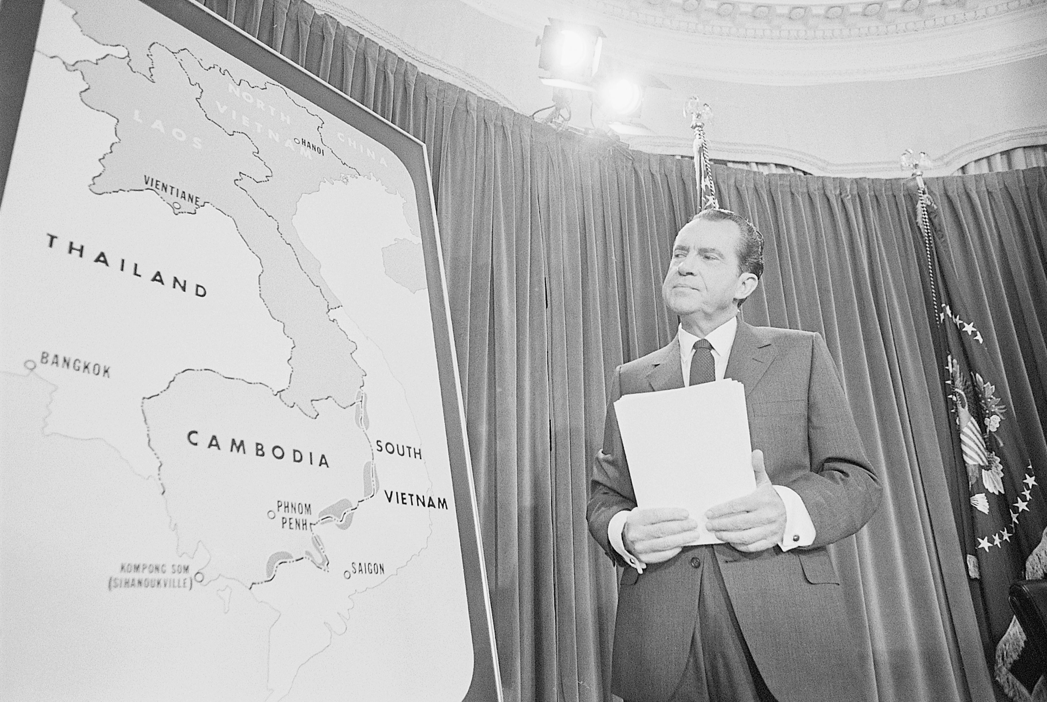 President Nixon Standing at Map of Cambodia
