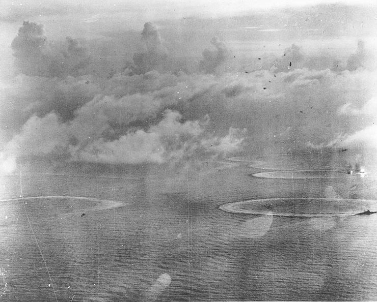Aerial photo of Japanese carriers under attack by American aircraft.