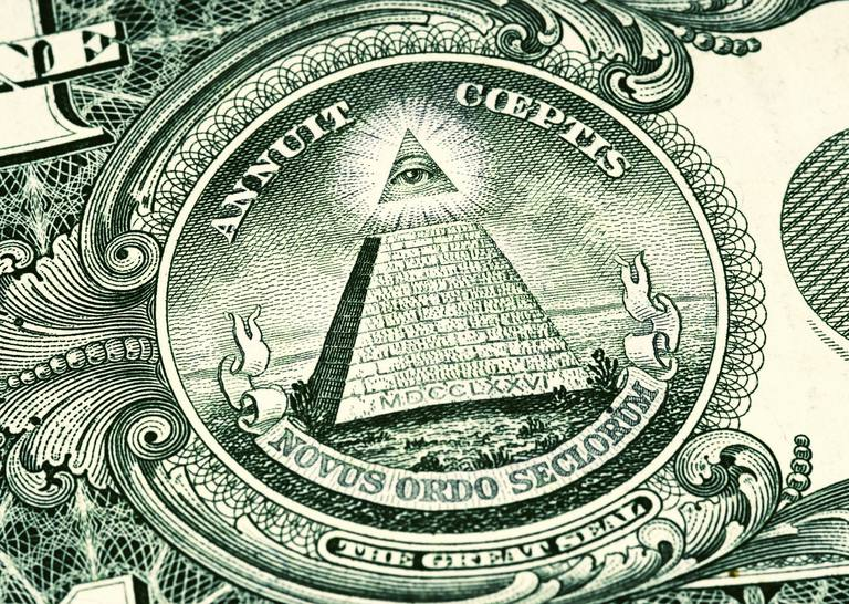 Close-up of the Latin phrases on an American dollar bill