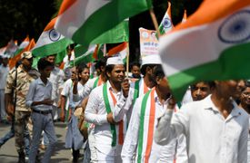 People holding Indian flags during the tri-colour march
