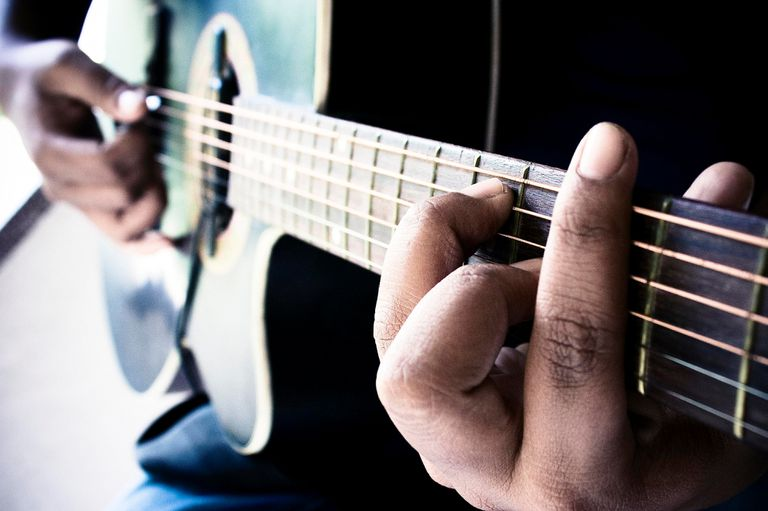 Man playing guitar chord