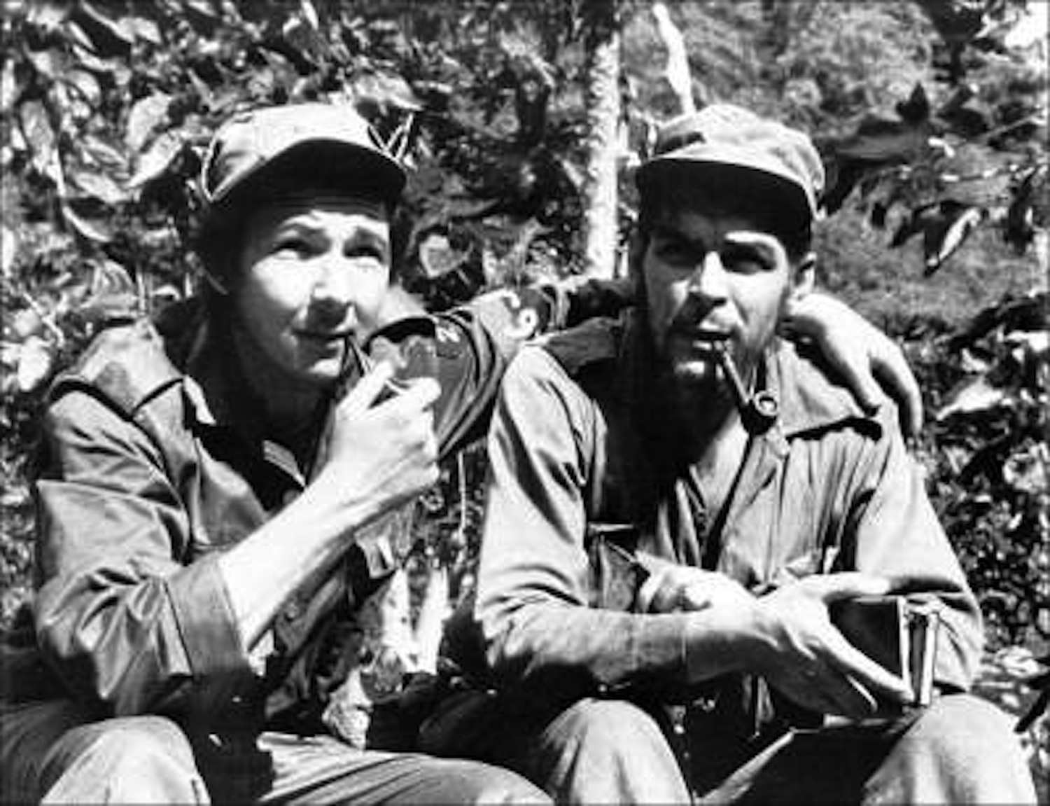 """Raúl Castro (left), with his arm around second-in-command, Ernesto """"Che"""" Guevara, in their Sierra de Cristal mountain stronghold in Oriente Province, Cuba, 1958"""