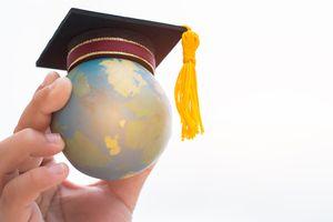 Graduation hat on top Earth globe model