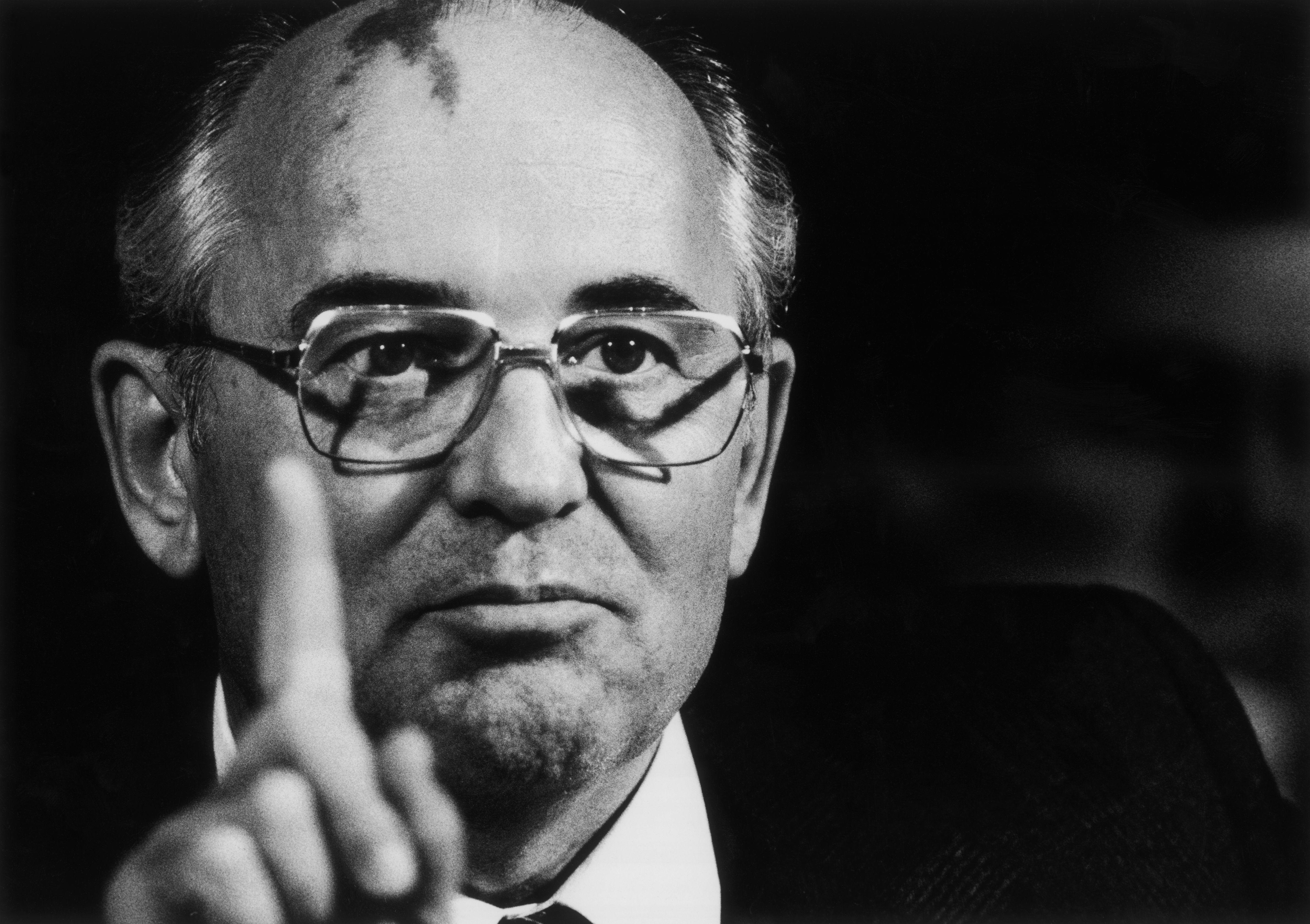 Mikhail Gorbachev pointing upwards in Iceland
