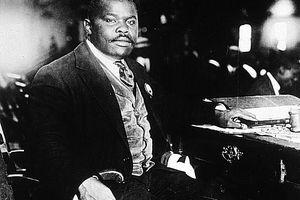 Marcus Garvey sitting at a desk, 1920